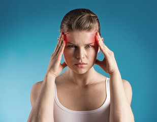 Young woman suffer from dizziness or vertigo holding head