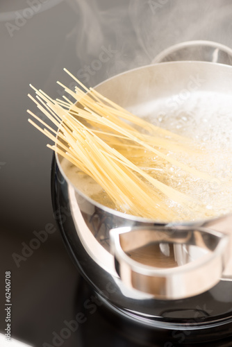 Pan with spaghetti cooking vertical