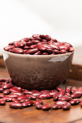 Bowl with raw red beans macro