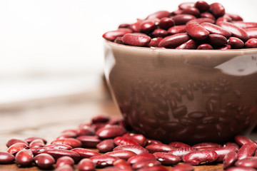 Bowl with raw red beans close up reflections