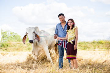 Couple farmer in farmer suit with on rice fields