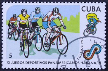 A stamp printed by CUBA shows cyclists.