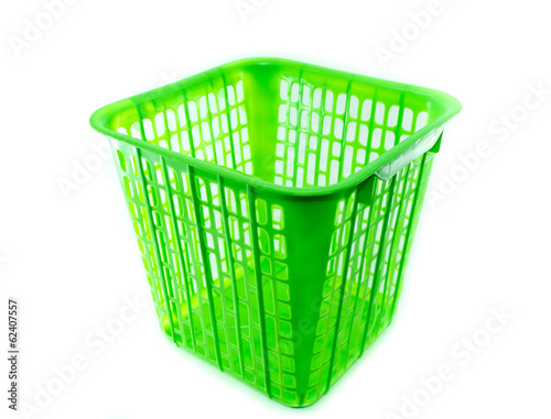 The green plastic basket  on white background