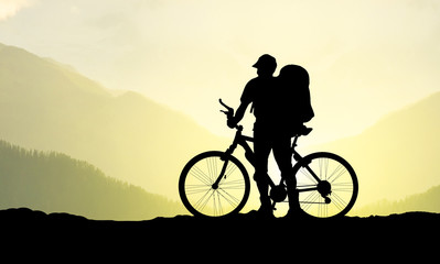 Silhouette of tourist and biker. Active life concept