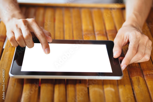 hands holding tablet with isolated screen