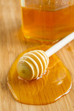 fresh honey poured on a wooden background