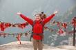 woman hiker open arms at peak of mountain huashan