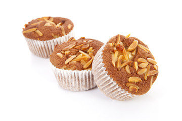 three biscuit cupcakes with nuts