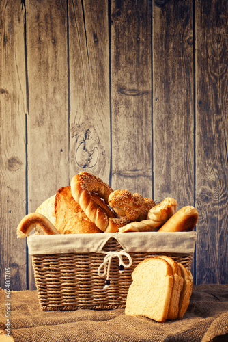 Delicious bread and rolls inwicker basket