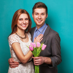 Beautiful couple in love with flowers tulips.Valentine's Day