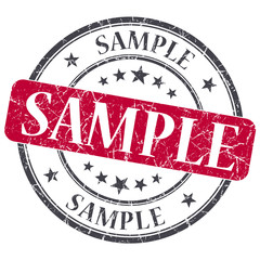 Sample red grunge round stamp on white background