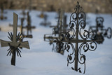 cemetery cross covered by snow