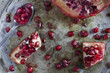 red and juicy pomegranate and grains on ancient tray with spoon