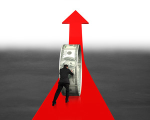 Businessman pushing money circle on growing red arrow