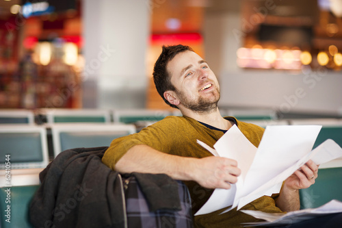Young man at the airport is going for holiday