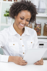 Mixed Race African American Girl Using Tablet Computer