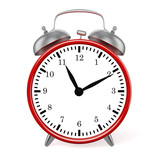 Red retro styled classic alarm clock isolated