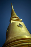 Golden pagoda on the sky background, thailand