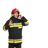 Shouting fireman using phone.