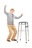 Old man with a walker raising his hands