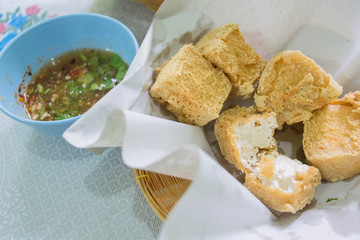 Fried tofu with sweet sauce.