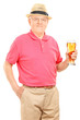 Senior man holding a pint of beer