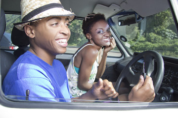 African American Couple laughing in the car