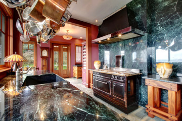 Luxury marble kitchen room with an antique style stove