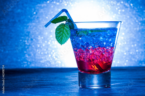 Layered cocktail with blue and red