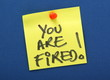 You Are Fired Yellow Sticky Note on a Notice Board