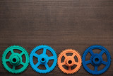 colorful gears on the wooden background