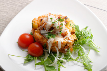 Delicious gourmet risotto with seafood, zucchinis and parsley