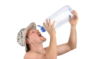 young man drinks from empty bottle