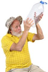 senior man looking into empty bottle