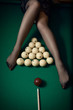 billiard ball aiming at sexy women legs in stockings