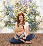 happy mother with adorable girl and teddy bear
