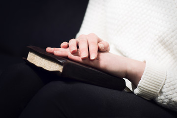 Woman pray with bible