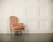 One classic armchair against a white wall and floor