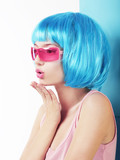 Manga Style. Charismatic Woman in Blue Wig Blowing a Kiss