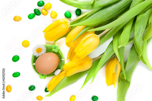 Egg in nest with tulip flowers