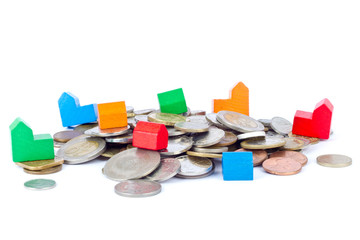 Toy houses on coins