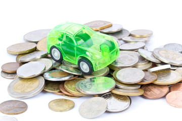 Green toy car on coins