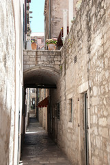 A narrow pathway between medieval buildings, Dubrovnik, Croatia