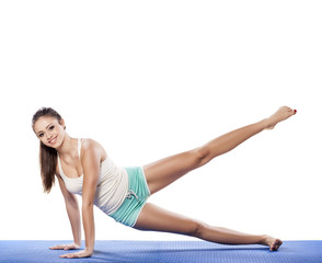 Young beautiful woman doing aerobics exercises