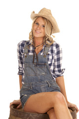 cowgirl on barrel overalls sit smile
