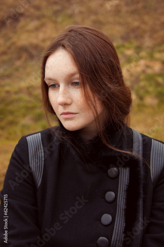 Portrait of a beautiful model with freckles on her face. Outdoor
