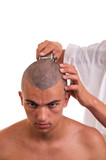 Man having a haircut with a hair clippers over a white backgroun
