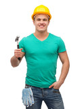 smiling manual worker in helmet with hammer