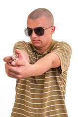 handsome young man pointing with toy gun against a white backgro