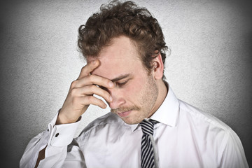 Worried businessman with hand on the head